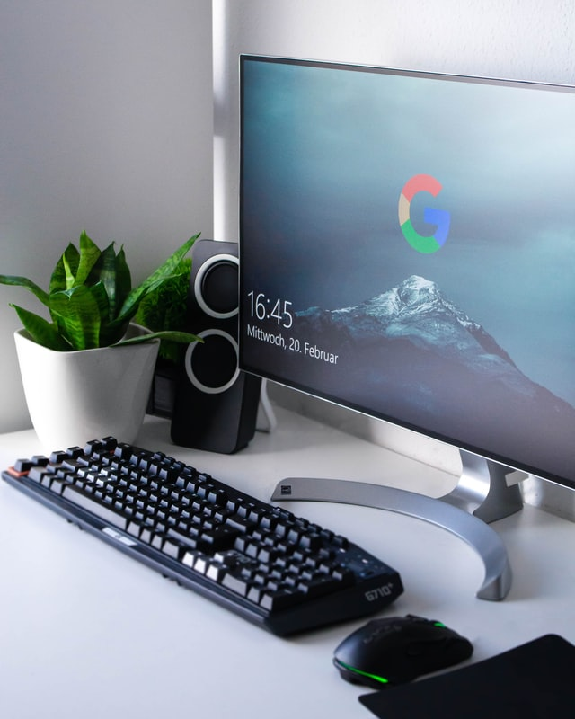 Google desktop PC with keyboard and mouse