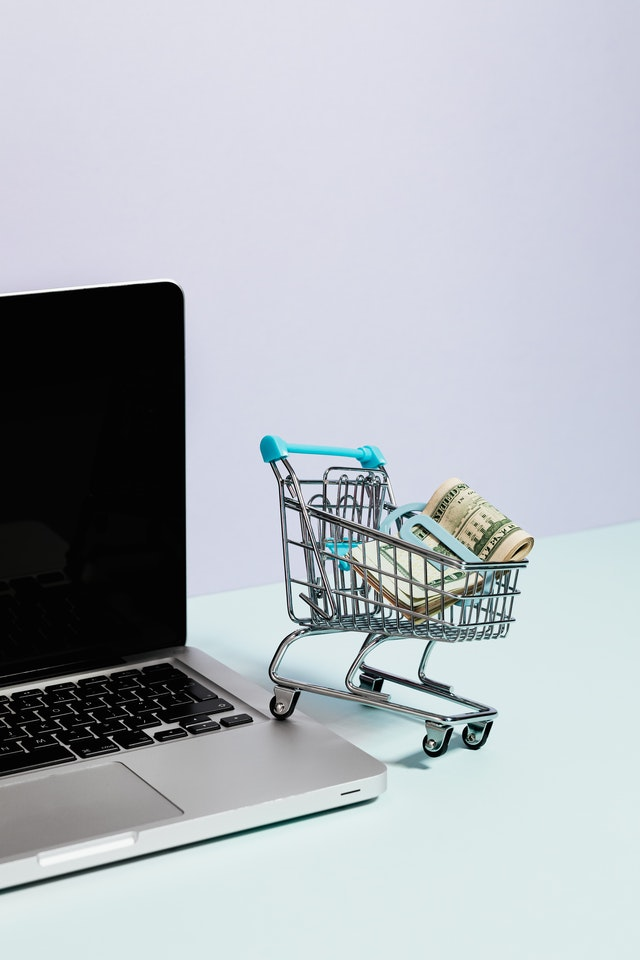 ecommerce goods containing kart with computer in a development agency SysComm International London